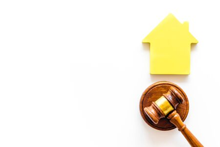 Inheritance of the house concept with figure and gavel on white background top view space for text Banco de Imagens