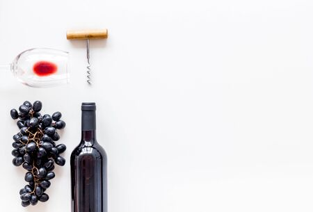 Open wine bottle. Top view white background space for text flat lay Фото со стока - 129787265