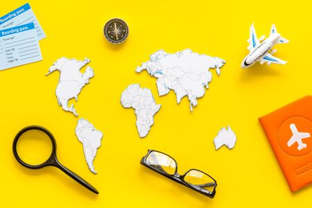 Planning a travel concept. Sketchy map of the world on yellow background top view 版權商用圖片