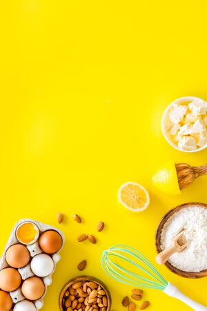 Baking background. Dough ingredients on yellow background top view space for text