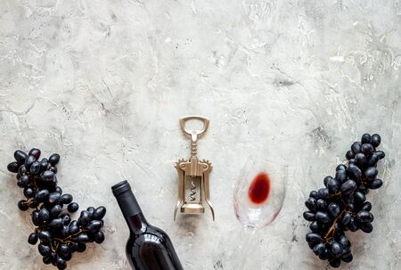 Composition with wine bottle on grey background top view space for text