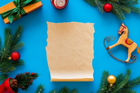Letter to Santa Claus concept. Paper on blue background with New Year decoration top view mockup space for text