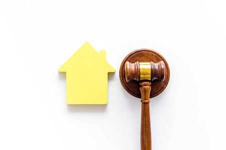 Inheritance of the house concept with figure and gavel on white background top view