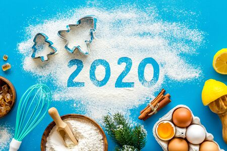 Happy New Year concept. 2020 written on blue baking background top view Stock Photo