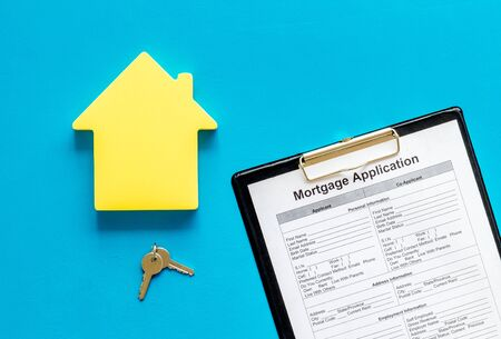 Mortgage application with house figure and keys on blue background top view Stock Photo