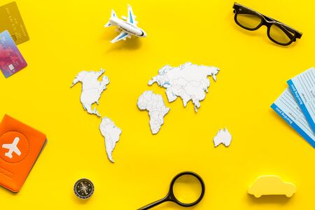 Planning a travel concept. Sketchy map of the world on yellow background top view Banco de Imagens