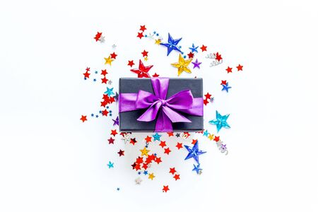 present in box with confetti on white background top view