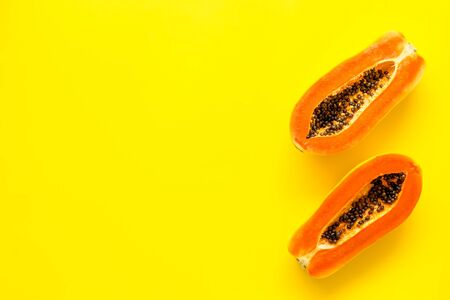 Ripe juicy papaya. Two halfs of papaya top view. 写真素材