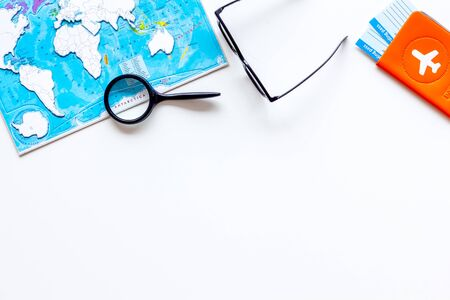 Planning a travel concept. Map of the world on white background top view copy space