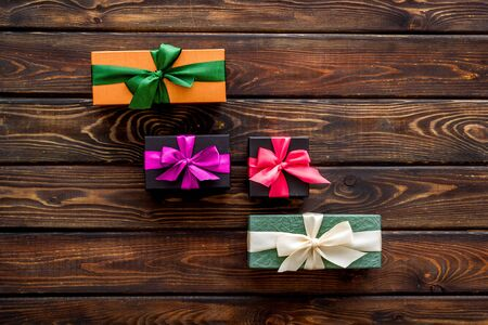 presents in boxes on wooden background top view copy space Imagens