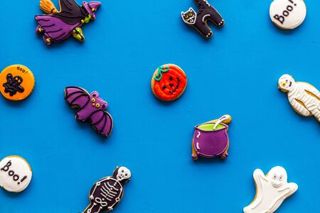 Pattern from halloween figures on blue background top view