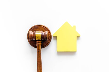 Inscribed gavel, house figure for inheritance concept on white background top view