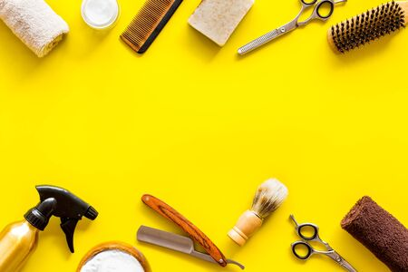 Mens shaving accessories on yellow background top view copy space