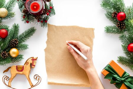 Write letter to Santa Claus concept. Paper on white background with New Year decoration top view mockup copy space Фото со стока - 129913256