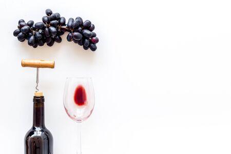Open wine bottle. Top view white background copy space Фото со стока