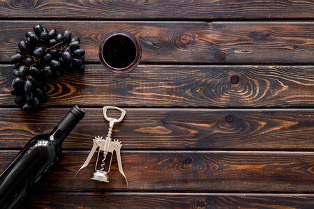 Open wine bottle. Top view dark wooden background copy space Фото со стока - 129913307