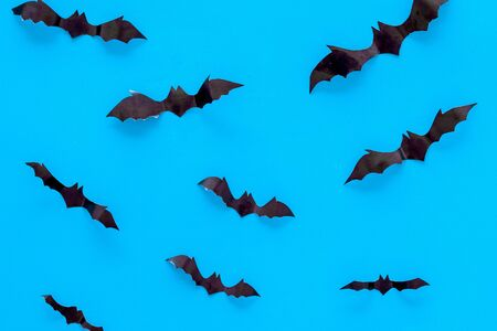 Halloween background with bats on blue table top view