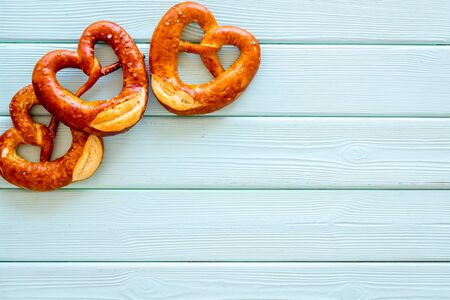 Pretzels frame, blue wooden background top view copy space