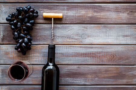 Open wine bottle. Top view dark wooden background space for text Фото со стока - 129913329