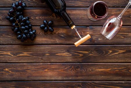 Composition with wine bottle on dark wooden background top view copy space Фото со стока