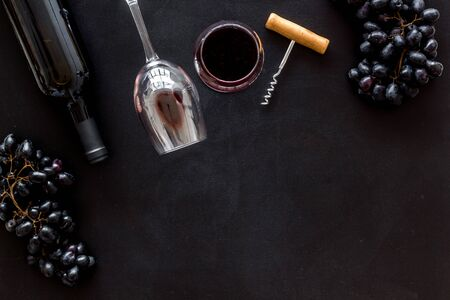 Composition with wine bottle on black background top view space for text