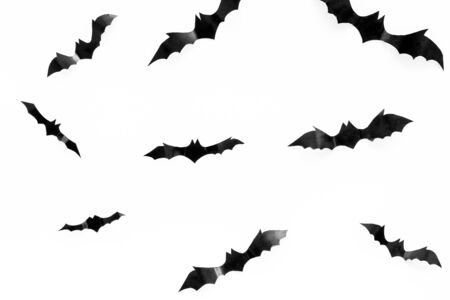 Halloween background with bats on white table top view.