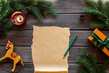 Letter to Santa Claus concept. Paper on dark wooden background with New Year decoration top view mockup copy space 版權商用圖片 - 129979511