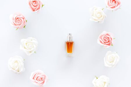 Perfume and flowers composition on white background top view. Archivio Fotografico