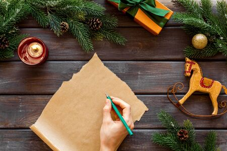 Write letter to Santa Claus concept. New Year decoation like spruce branch and gifts. Hand writes letter 写真素材