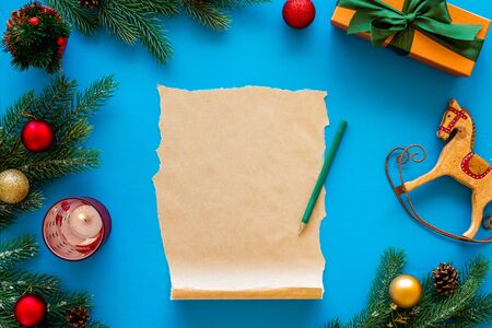 Write letter to Santa Claus concept. New Year decoation like spruce branch and gifts. 写真素材