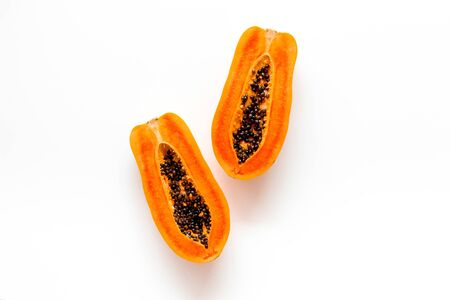 Ripe juicy papaya on white background top view copy space