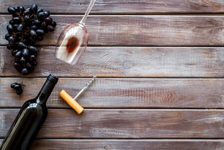 Composition with wine bottle on dark wooden background top view space for text Фото со стока - 130017996