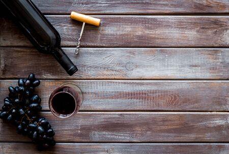 Red wine bottle near grape, wineglass and corkscrew 写真素材