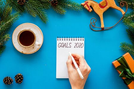 New Year goals concept. Notebook for writting resolution on blue background top view 版權商用圖片