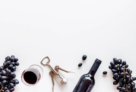 Open wine bottle. Top view white background space for text flat lay Фото со стока