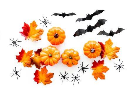 Halloween composition with pumpkins, spiders and bats on white background top view