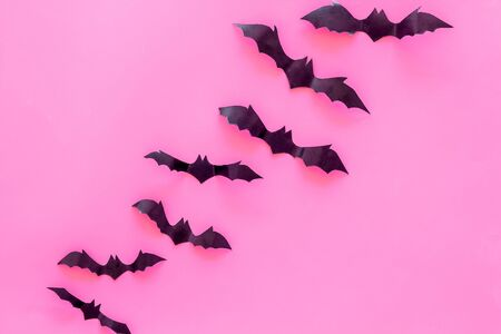 Halloween design. Bats on pink background top view copy space
