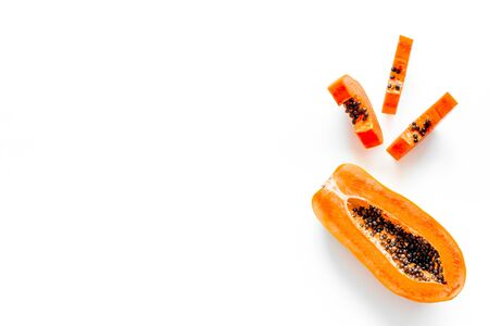 Sliced papaya on white background top view copy space