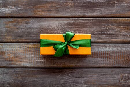 presents in boxes on wooden background top view copyspace