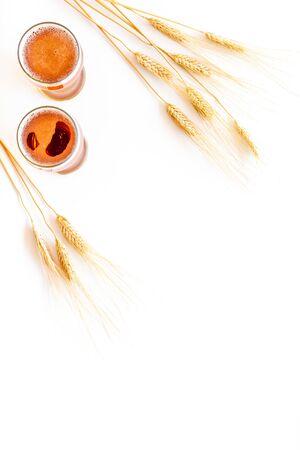 Barley or wheat as beer ingredient near beer glasses on white background top view copy space 版權商用圖片