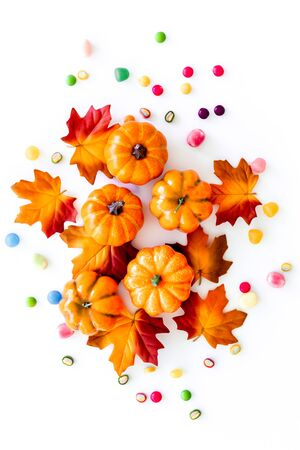 Halloween composition with sweets on white background top view.