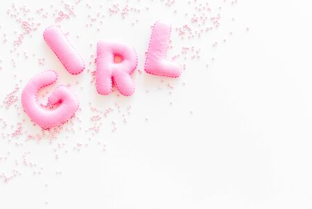 Girl word as decoration for baby shower on white background top view frame copy space Stock Photo