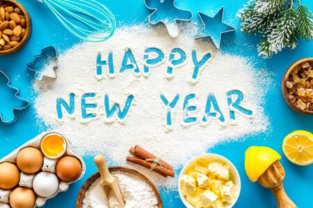 Happy New Year written on blue baking background top view Stock Photo