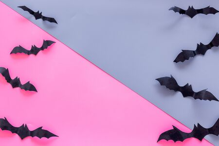 Bats cutout on Halloween frame on pink and blue table top view space for text Stock Photo