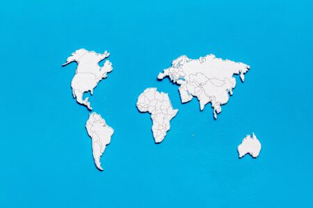 Planning a travel concept. Sketchy map of the world on blue wooden background top view 版權商用圖片