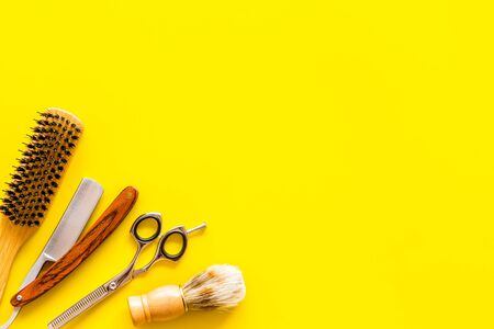 Barbershop concept. Hairdressing tools on yellow background top view space for text