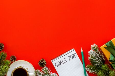 New Year routine. Notebook with goals 2020 on red background top view copy space 写真素材