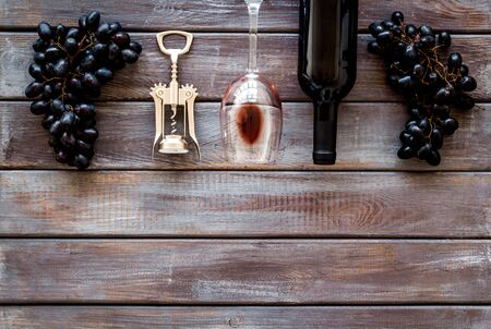 Open wine bottle. Top view dark wooden background space for text
