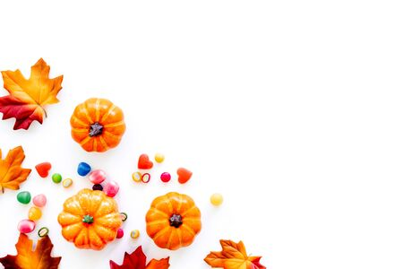 Halloween composition with sweets on white background top view frame space for text