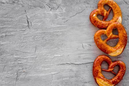 Pretzels frame, grey background top view copy space